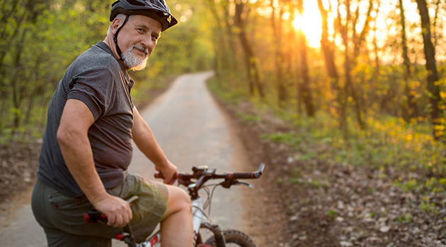 elderly man on a bike
